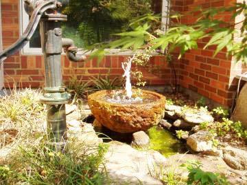 既存の井戸を生かした水場の写真